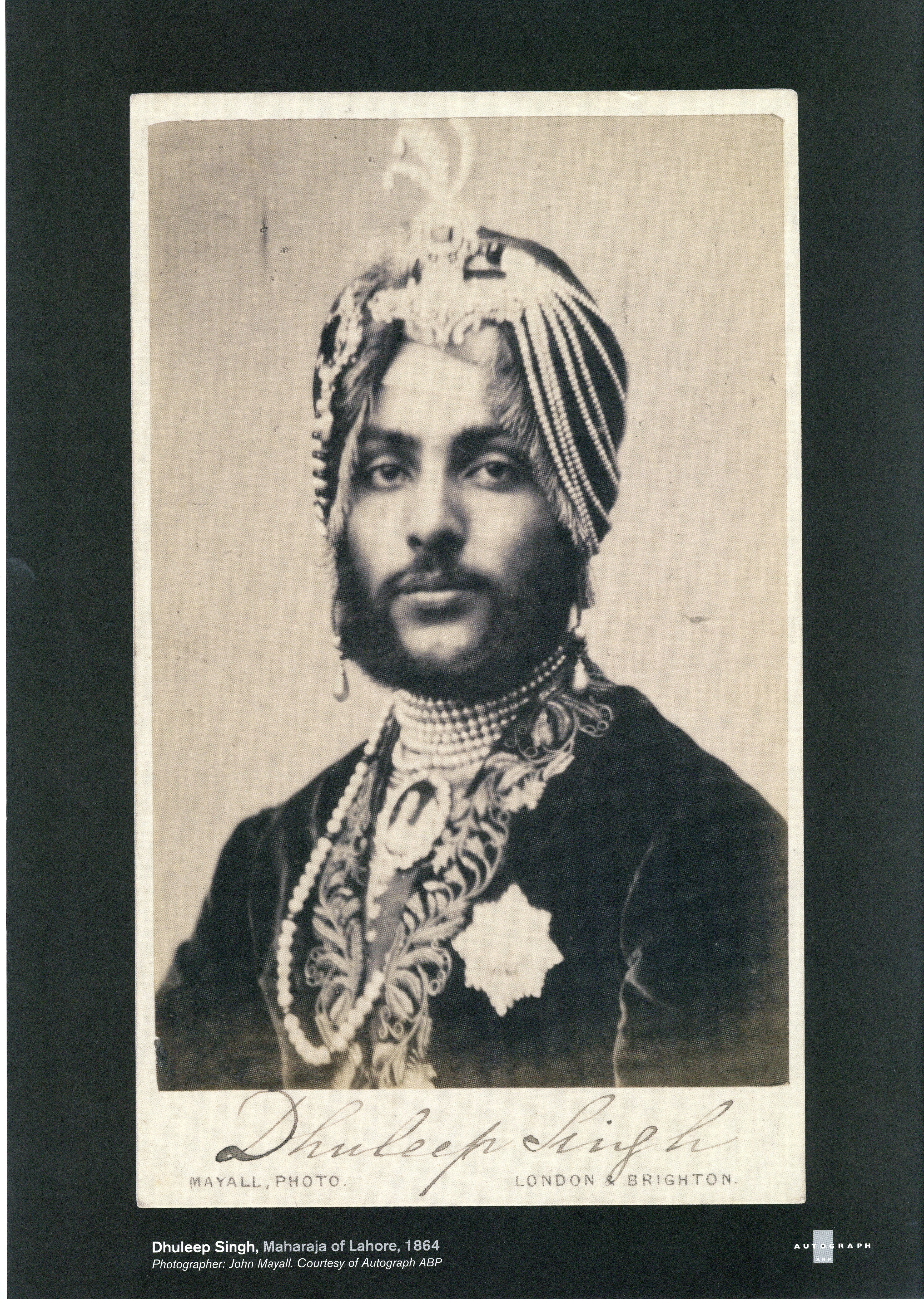 Black and white photograph of South Asian man with elaborate turban, moustache and short beard. Text reads Dhuleep Singh Maharajah of Lahore 164. Photographer Jon Mayall Courtesy of Autograph ABP