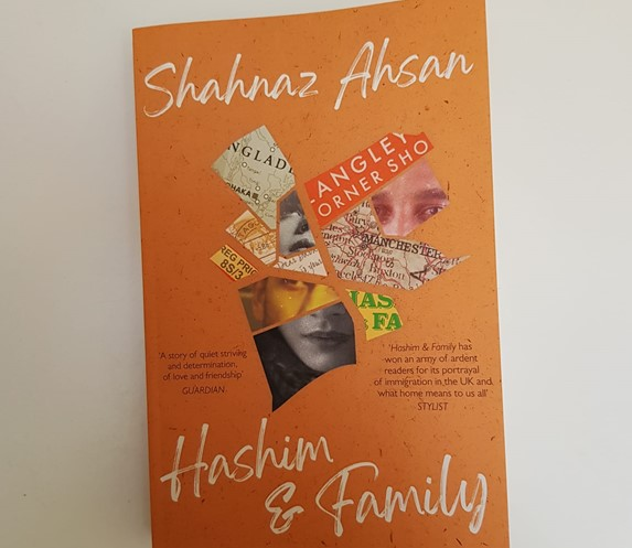 Cover of Hashim & Family orange background with collage of images arranged in the shape of the map of Bangladesh